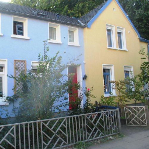 Maler Bielefeld, Fassaden-Gestaltung und mineralische Dämmung eines Doppelhauses in Bielefeld durch Stenner und Keitel